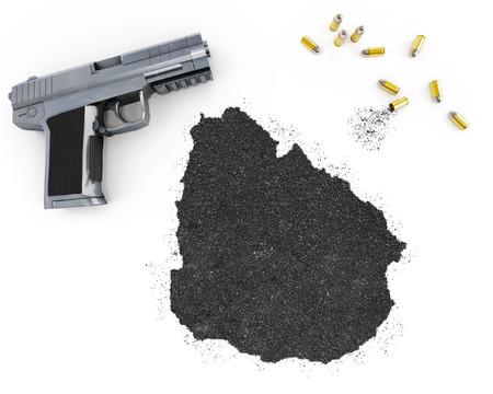 gunpowder: Gunpowder forming the shape of Uruguay and a handgun.(series) Stock Photo