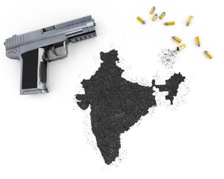 blackmail: Gunpowder forming the shape of India and a handgun.(series) Stock Photo