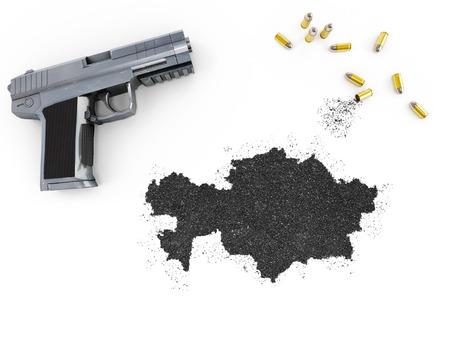 gunpowder: Gunpowder forming the shape of Kazakhstan and a handgun.(series) Stock Photo