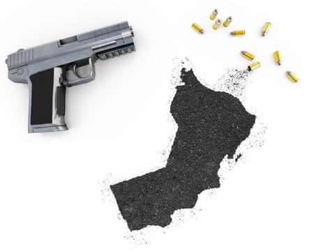 gunpowder: Gunpowder forming the shape of Oman and a handgun.(series) Stock Photo