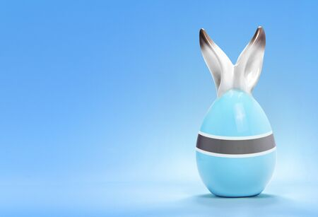 botswanan: Colorful cute ceramic easter egg with rabbit ears and the flag of Botswana .(series)