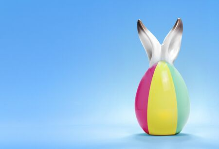 Colorful cute ceramic easter egg with rabbit ears and the flag of Guinea .(series) photo