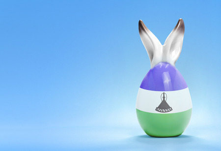 rabbit ears: Colorful cute ceramic easter egg with rabbit ears and the flag of Lesotho .(series)