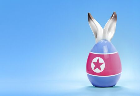 Colorful cute ceramic easter egg with rabbit ears and the flag of North Korea .(series) Stock Photo