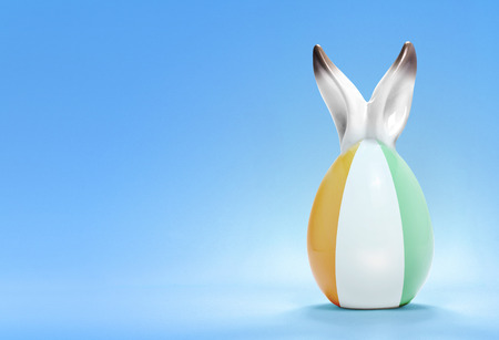 Colorful cute ceramic easter egg with rabbit ears and the flag of Ivory Coast .(series) photo