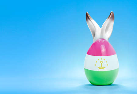 spring  tajikistan: Colorful cute ceramic easter egg with rabbit ears and the flag of Tajikistan .(series)