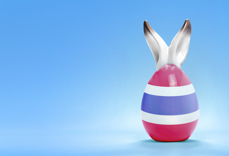 rabbit ears: Colorful cute ceramic easter egg with rabbit ears and the flag of Thailand .(series) Stock Photo