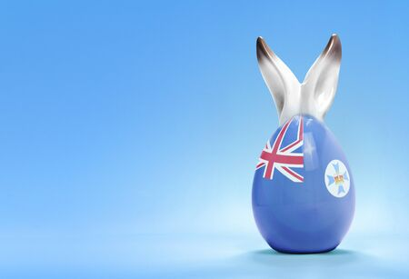 queensland: Colorful cute ceramic easter egg with rabbit ears and the flag of Queensland .(series)