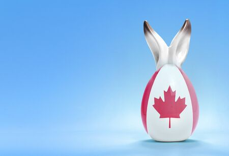 rabbit ears: Colorful cute ceramic easter egg with rabbit ears and the flag of Canada .(series)