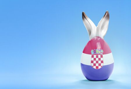 Colorful cute ceramic easter egg with rabbit ears and the flag of Croatia .(series) photo