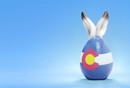 colorado flag: Colorful cute ceramic easter egg with rabbit ears and the flag of Colorado .(series) Stock Photo