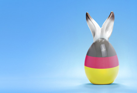 rabbit ears: Colorful cute ceramic easter egg with rabbit ears and the flag of Germany .(series)