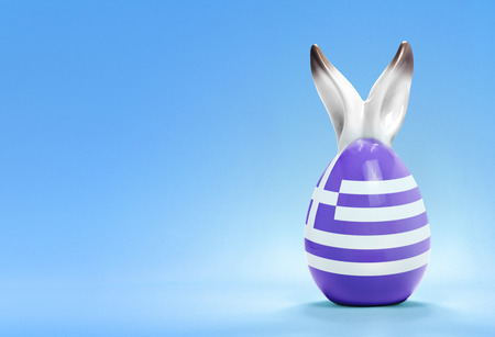 Colorful cute ceramic easter egg with rabbit ears and the flag of Greece .(series)