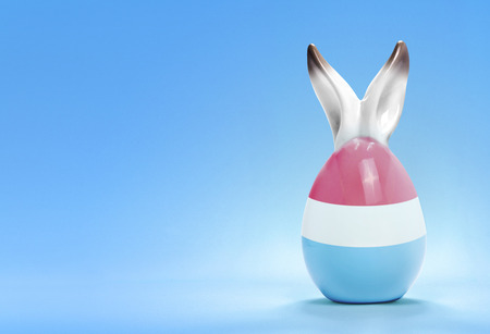 Colorful cute ceramic easter egg with rabbit ears and the flag of Luxembourg .(series) photo