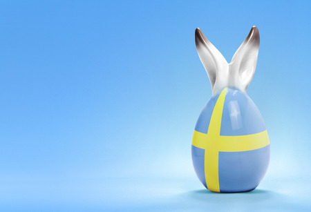 rabbit ears: Colorful cute ceramic easter egg with rabbit ears and the flag of Sweden .(series)
