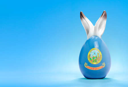 yelllow: Colorful cute ceramic easter egg with rabbit ears and the flag of Idaho .(series)