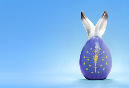 rabbit ears: Colorful cute ceramic easter egg with rabbit ears and the flag of Indiana .(series)