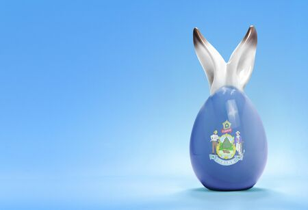 rabbit ears: Colorful cute ceramic easter egg with rabbit ears and the flag of Maine .(series)