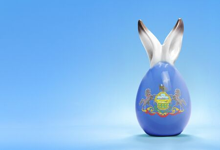 rabbit ears: Colorful cute ceramic easter egg with rabbit ears and the flag of Pennsylvania .(series)