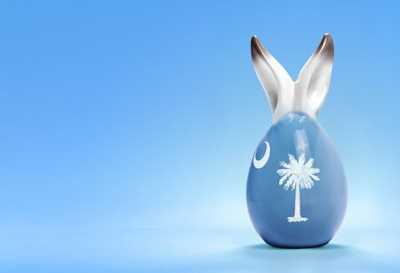rabbit ears: Colorful cute ceramic easter egg with rabbit ears and the flag of South Carolina .(series) Stock Photo