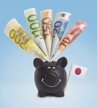 twenty euro banknote: Ten,twenty,fifty,one hundred and a 200 Euro banknote in a smiling piggybank of Japan.(series) Stock Photo