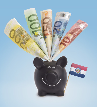 twenty euro banknote: Ten,twenty,fifty,one hundred and a 200 Euro banknote in a smiling piggybank of Missouri.(series)