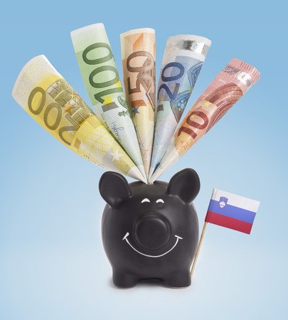 twenty euro banknote: Ten,twenty,fifty,one hundred and a 200 Euro banknote in a smiling piggybank of Slovenia.(series)