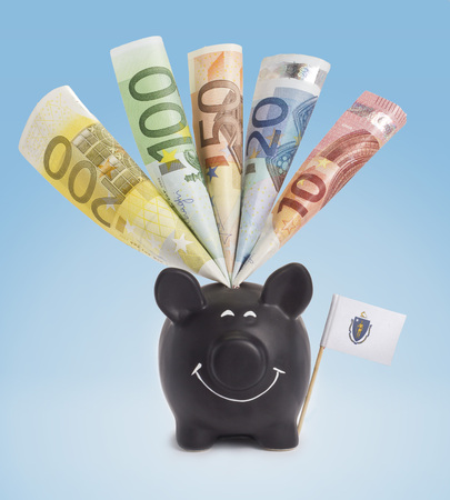 fifty euro banknote: Ten,twenty,fifty,one hundred and a 200 Euro banknote in a smiling piggybank of Massachusetts.(series) Stock Photo