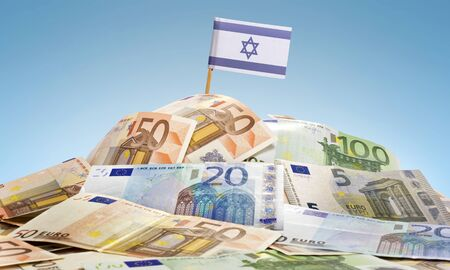 The national flag of Israel sticking in a pile of mixed european banknotes.(series) Stock Photo