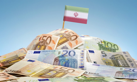 The national flag of Iran sticking in a pile of mixed european banknotes.(series) Stock Photo