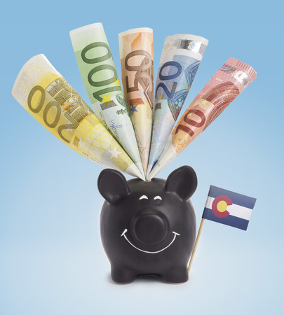 twenty euro banknote: Ten,twenty,fifty,one hundred and a 200 Euro banknote in a smiling piggybank of Colorado.(series)