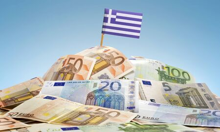 The national flag of Greece sticking in a pile of mixed european banknotes.(series)