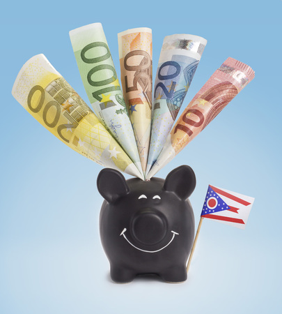 twenty euro banknote: Ten,twenty,fifty,one hundred and a 200 Euro banknote in a smiling piggybank of Ohio.(series) Stock Photo