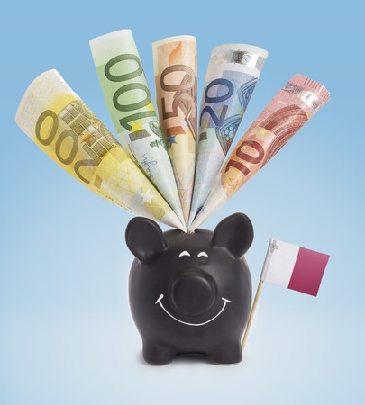 twenty euro banknote: Ten,twenty,fifty,one hundred and a 200 Euro banknote in a smiling piggybank of Malta.(series)