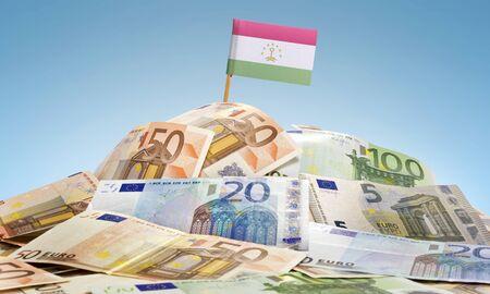 economy of tajikistan: The national flag of Tajikistan sticking in a pile of mixed european banknotes.(series) Stock Photo