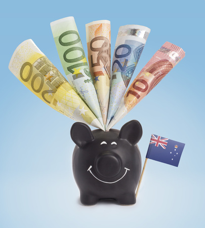 fifty euro banknote: Ten,twenty,fifty,one hundred and a 200 Euro banknote in a smiling piggybank of Victoria.(series) Stock Photo
