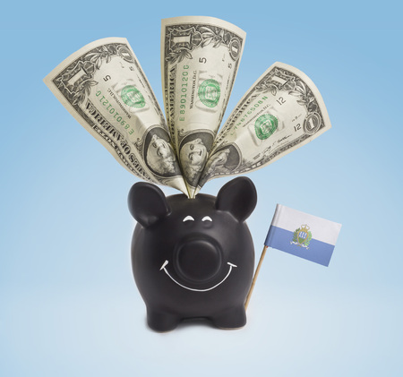 One dollar banknote in a smiling piggybank of San Marino.(series) photo