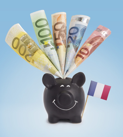 twenty euro banknote: Ten,twenty,fifty,one hundred and a 200 Euro banknote in a smiling piggybank of France.(series) Stock Photo