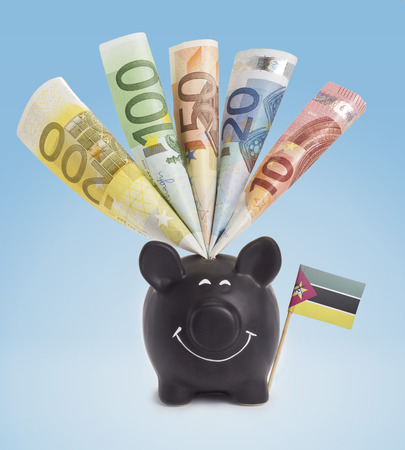 twenty euro banknote: Ten,twenty,fifty,one hundred and a 200 Euro banknote in a smiling piggybank of Mozambique.(series)
