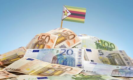stock investing: The national flag of Zimbabwe sticking in a pile of mixed european banknotes.(series) Stock Photo