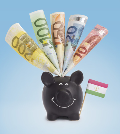fifty euro banknote: Ten,twenty,fifty,one hundred and a 200 Euro banknote in a smiling piggybank of Tajikistan.(series)