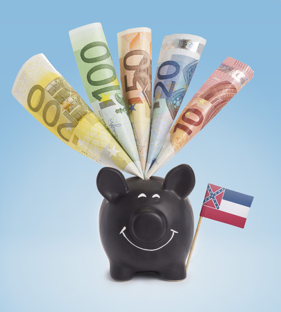 fifty euro banknote: Ten,twenty,fifty,one hundred and a 200 Euro banknote in a smiling piggybank of Mississippi.(series)
