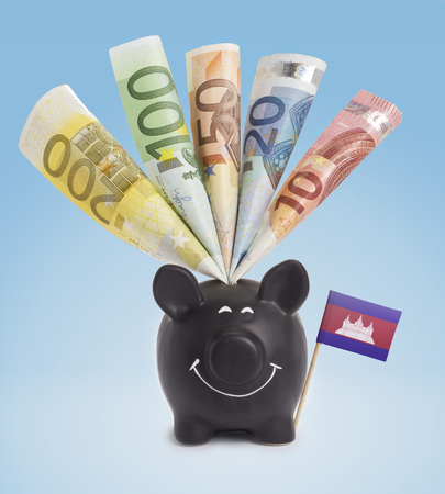 fifty euro banknote: Ten,twenty,fifty,one hundred and a 200 Euro banknote in a smiling piggybank of Cambodia.(series)