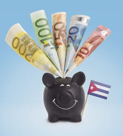 twenty euro banknote: Ten,twenty,fifty,one hundred and a 200 Euro banknote in a smiling piggybank of Cuba.(series)