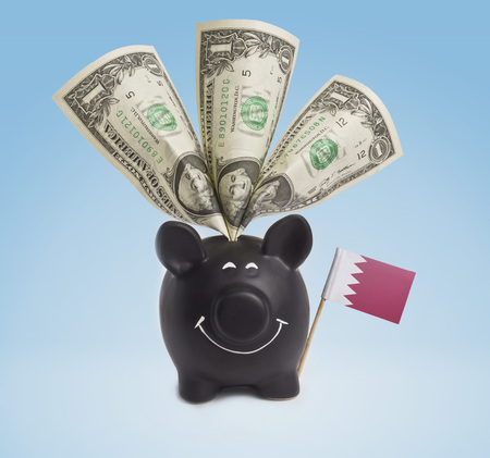 bahrain money: One dollar banknote in a smiling piggybank of Bahrain.(series)