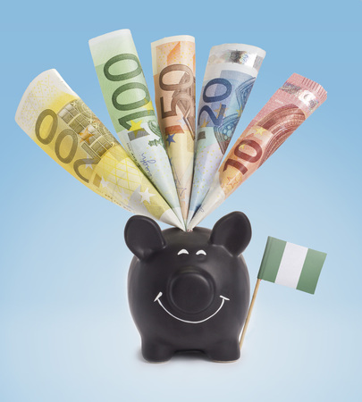 twenty euro banknote: Ten,twenty,fifty,one hundred and a 200 Euro banknote in a smiling piggybank of Nigeria.(series)