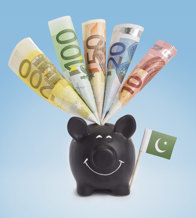 twenty euro banknote: Ten,twenty,fifty,one hundred and a 200 Euro banknote in a smiling piggybank of Pakistan.(series) Stock Photo