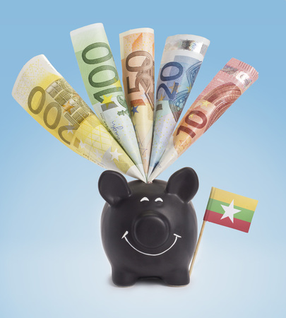 fifty euro banknote: Ten,twenty,fifty,one hundred and a 200 Euro banknote in a smiling piggybank of Burma.(series) Stock Photo