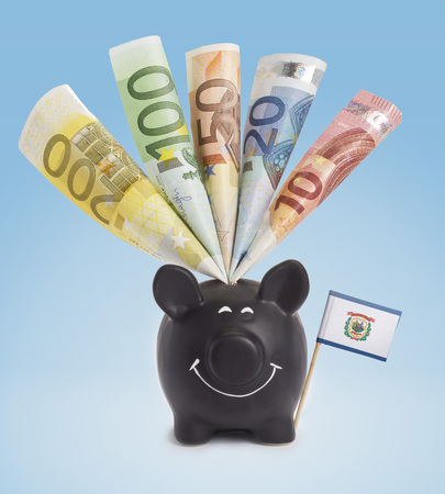 twenty euro banknote: Ten,twenty,fifty,one hundred and a 200 Euro banknote in a smiling piggybank of West Virignia.(series)