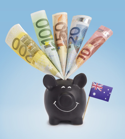 fifty euro banknote: Ten,twenty,fifty,one hundred and a 200 Euro banknote in a smiling piggybank of Australia.(series)